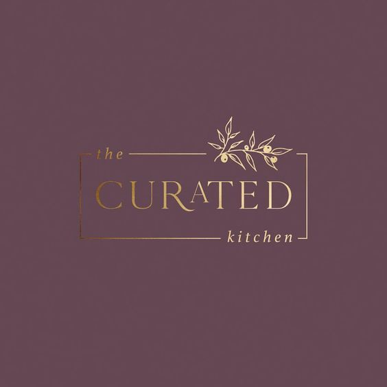 the curated kitchen golden logo